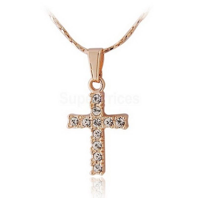 кулон в виде крестика с кристаллами на цепочке.